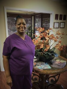 Black woman purple nurse clothing